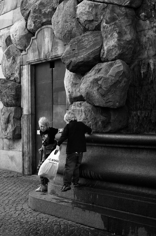 Stockholm- Playing by a fountain