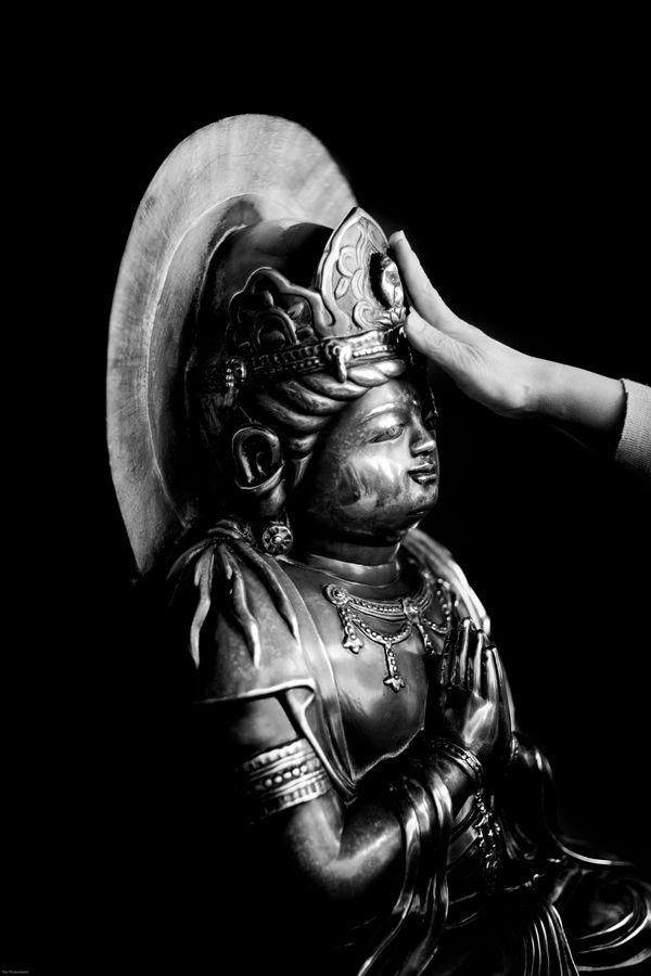 TOUCHING BUDDHA